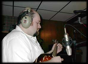 George records a mandolin part.